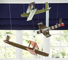 Wood Hanging Biplane. This would be so cute in an airplane room!
