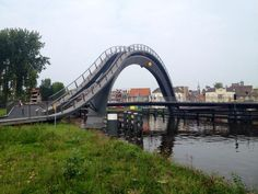 Pedestrian and cycle bridge at Melkwegbridge, Purmerend, NL by NEXT Architects and Rietveld Landscape. Click to tweet & support the slowottawa.ca boards >> http://www.pinterest.com/slowottawa/