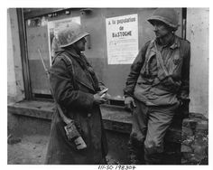 Bastogne, Belgium-Weary infantrymen of the 110th Regt., 28th Div., US 1st Army following the German breakthrough in that area. The enemy overran their battalion. (L-R) Pvt. Adam H. Davis and T/S Milford A. Sillars. Dec. 19, 1944 (US National Archives)