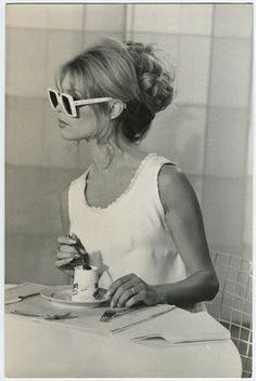 Brigette Bardot bun hairstyle and white sunglasses