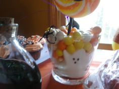 Halloween peeps with candy corn and Halloween m's. Adorned with a cute lollipop.