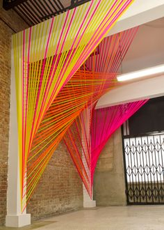 Megan Geckler's installations look like a burst of fluorescent light; a show of bold colours cutting through industrial spaces. Geckler uses bright flagging tape - the kind you find just off the...