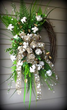 """This wreath is much prettier in person....full of greenery, cotton balls with pods, and matching ribbon. It's 30"""" x 22"""" ..$45"""