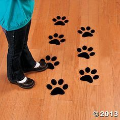 Paw Print Floor Decals - Oriental Trading. It'd be fun to have them lead to the kids area or program room!