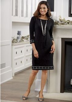Holiday Trim Dress from Monroe and Main. The perfect, slimming black dress spruces up with a touch of glitter at cuffs and hem will add just-right gleam to your movement.