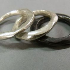 Made to look like liquid or molten silver, this handcrafted organic ring is ideal for women and men a like    Shown here with a matte ring as well