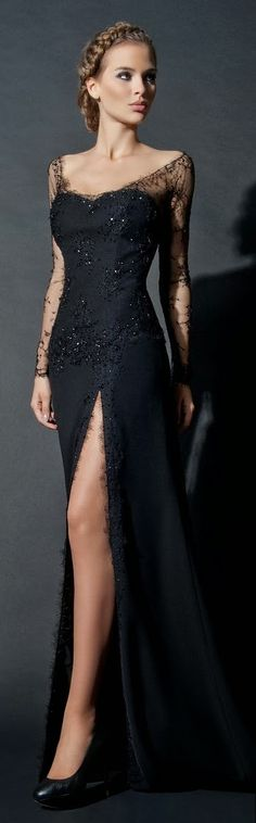 long black dress with lace sleeves.