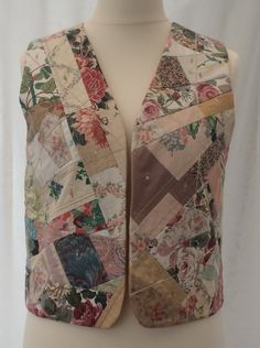 """Ref: 148 short vintage patchwork chintz embroidered applique Please check measurements against a garment you wear. To nearest half-inch: Back neck to hem 19.5"""", Back underarm to underarm 19"""", Side underarm to hem 9"""" Each front panel side seam to front opening 10"""", Armhole circumference 25"""" further information contact Jackie Wills www.jackiewills.com"""