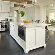 Gray Kitchen Cabinets with White Island and Rope and Seeded Glass Light Pendants