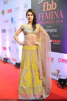 Do yellow like this Miss India International 2011 Ankita Shorey posing at fbb Femina Miss India 2014. #lehenga #choli #indian #hp #shaadi #bridal #fashion #style #desi #designer #blouse #wedding #gorgeous #beautiful