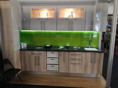 Full unit showcased at the Home Makers Expo in The green splashback draws your eye immediately and the Corian top is very practical. Corian Top, Splashback, Cabinet Doors, 3d Design, Homemaking, Kitchens, Kitchen Cabinets, The Unit, Eye