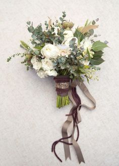 I love the organic-ness of this bouquet. The colors, the ribbon..
