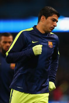 Luis Suarez of Barcelona warms up during the UEFA Champions League Round of 16 match between Manchester City and Barcelona at Etihad Stadium on February 24, 2015 in Manchester, United Kingdom.