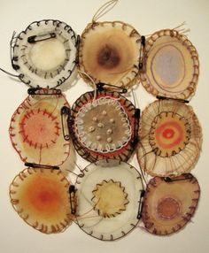 "Michelle Moode; these are 1""-2"" circles of mulberry paper with watercolor, tea, and beeswax, delicately attached to each-other with tiny safety pins."