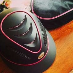 Pink and black GPA first lady helmet and matching Ogilvy saddle pad.....if only GPA's fit my small head