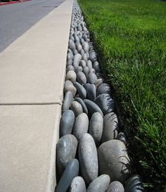 Garden Ideas. Beach Stone Garden Edging - Have to think about this one.