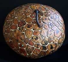 decorative gourds | carved gourd - each section has a scene.