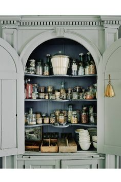 [i]A useful storage cupboard is built-in to an alcove in the dining room.[/i]