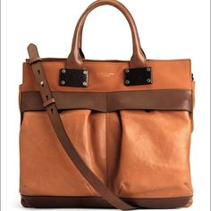 """Rag & Bone Large Pilot in Walnut This Tag & Bone bag is to DIE for! Soft rich brown leather with deeper brown trim. Comfortable rolled handles are easy to grasp. A 20"""" adjustable strap drop with shoulder pad frees up hands for other items. Lots of interior pockets and exterior flap cover pouches keep everything organized and within easy reach! 12""""w by 12"""" high with a 4"""" wide flat base. Zippered top to keep everything secure. This is an awesome career or travel bag! Comes with authenticity…"""