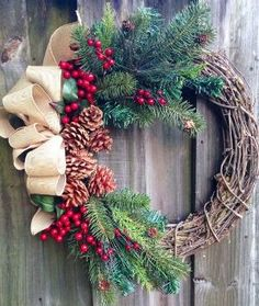 Winter wreath or Christmas wreath using grapevine, red berries, pine, and pine cones with a tan burlap-look bow. on Etsy, $65.00 by shelley