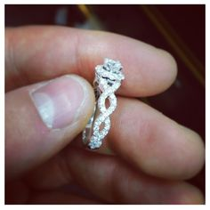 Infinity twisted band. Halo style engagement ring