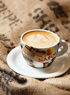 What an inviting cup of latte coffee!.