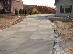 Concrete driveway checkered pattern brush texture