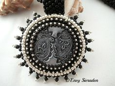 Bead embroidery necklace.A polymere clay cabochon(yin and yang) beaded with miyuki seedbeads,delica`s and little swarovski pearls in the colors black