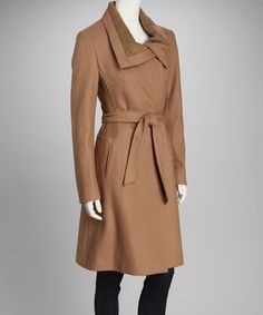 Stand out in style on even the chilliest day with this luxurious wool-blend coat. Cozy knit panels decorate each side in addition to the chic, overlapped collar, while an adjustable tie sash encourages a flattering fit.