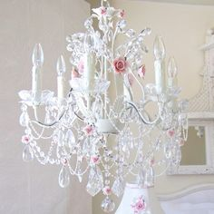 Another gorgeous find on The Bella Cottage site. If your like me and love charming vintage finds then you'll love this one! This 6- light crystal chandelier is adorned with pink porcelain roses, draped with layers of crystal chain swags and decorated with fancy-cut French pendants, gorgeous glass bobeches and a multitude of crystal teardrops. Delicate beaded pearl chains add a dreamy-refined touch to this exquisitely luxurious chandelier, truly a Fairy-tale beauty.