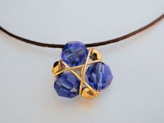 Zelda Necklace Zora's Sapphire, Dark Blue Crystals, Genya Cord. $12.50, via Etsy.