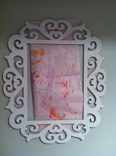 Display your kid's art! (burnout frame/Michaels; white spray paint; 3M Command strips for easy on/off the wall). Change out the art throughout the school year.