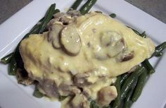Creamy Mushroom Chicken. Super easy to make and wayyyy too de-lish to forget! Here it is: 4 frozen chicken breasts, 8 oz can of mushrooms (pieces and stems), 1 can of condensed Campbell's Cream of Chicken & Mushroom Soup, 8 oz cream cheese, cubed. Throw it all in crock pot - yes - frozen chicken. Turn to high, and leave it for 6 hours! Serve on fresh green beans or asparagus. Super simple, super delicious.