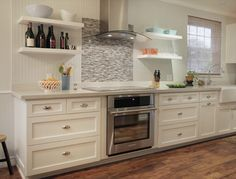 the tile shop: glass backsplash with stainless steel behind the