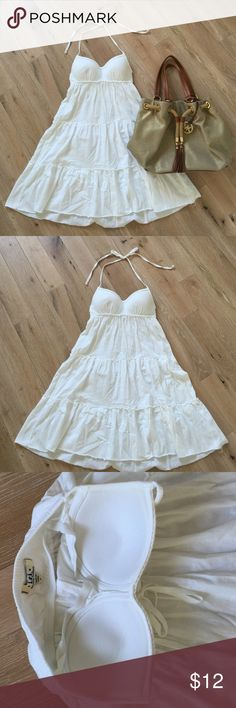 White Halter Dress Gently used. Has a built in bra that is NOT see thru so no worries of exposure. lei Dresses Midi