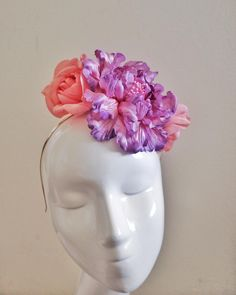 Race Day Inspiration: A new a colourful headpiece for this seasons races she is a fun take on the flower crown. Made up of a giant and breathtaking purple peony with pink stamens and two peachy roses both hand painted on a gold metal headband. $290. Custom colours available.  #australiandesigner #millinery #melbournecup #racingfashion #fashion #fascinators #fashionsonthefield #couture #custommade #caulfieldcup #ascotraces #racingcarnival2015 #myerfashionsonthefield #hat #sydney #inspiration… Fascinator, Headpiece, Carnival 2015, Purple Peonies, Races Fashion, Metal Headbands, Race Day, Flower Crown, Silk Flowers