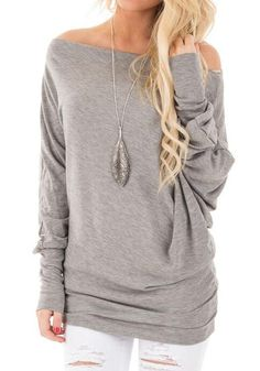 Going for chic and street-ready look? Wear this grey boat neck tee with style by teaming it up with necklace, tight pants and boots. See more amazing items at Fichic.com !