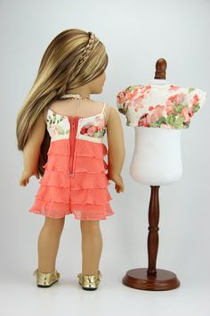 This listing is for a ruffled tank top dress and bolero style shrug. The dress is made with a coral colored ruffled knit fabric on the bottom
