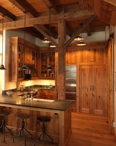 Rustic Kitchen Design - Very nice. I wish there was more stone or tile to balance the wood out but I love it none the less.