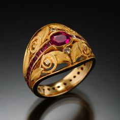 ring. Tom Herman's Jewellery. Not all Tom's pieces focus on precious stones; his precious metal carving is spectacular enough to stand alone. Some of his most popular carvings, including laurel, oak, and ginkgo leaves, have been rendered in earrings, rings, cufflinks, brooches, and bracelets. Throughout his work, Tom has cultivated his talents and created pieces of art that will be worn and admired for many generations to come.