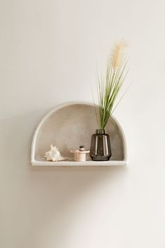 Shop our serene home decor and furniture collection only at Urban Outfitters. Decorate your space with neutral furniture pieces, shell accents, stone ceramics, and more! Storage Shelves, Shelving, Record Storage, Stucco Finishes, Urban Outfitters, Flat Shapes, Apartment Furniture, Concrete Wall, Craft Stick Crafts