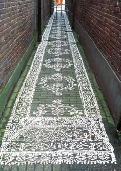 .an alleyway made pretty with painted runner.
