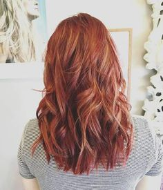 Dyed red hair, medium long, curled