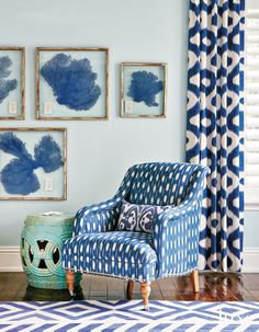 An Odette chair by Jayson Home in Mark Alexander's Tashkent Indigo fabric from Romo located in the family room sits besides a weathered garden stool.