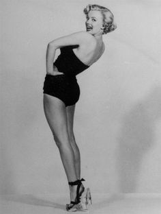 Image detail for -FILE - In this undated file photo, actress Marilyn Monroe is pictured mimicking Betty Grable's famous World War II pin-up pose. (AP Photo, File)
