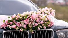 Image of 'Wedding car decorated with bunch of flowers'