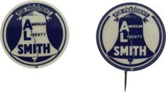 A pair of Liberty Bell slogan pins from Al Smith's presidential campaign.