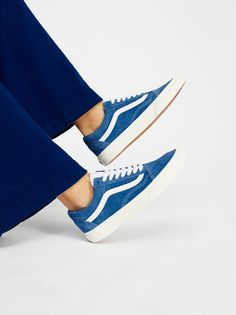 Old School Retro Sport Sneaker | **Fit:** This style is in unisex sizing so a men's size 4.5 is a women's size 6.  Retro-inspired suede kicks with classic Vans stripes on the sides.  * Lace-ups * Rubber outsole * Contrast tongue