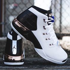 """Back in 2002 His Airness returned to the game of basketball for the third time while introducing a new model  the Air Jordan XVII. Purchase the """"Copper"""" and """"Bulls"""" colorways at kickbackzny.com."""