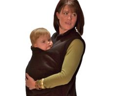 Keep your baby close to your heart with this ridiculous looking baby carrier. You'll be like a kangaroo with a pouch. Until they learn to walk you'll be forced to use something like this or an unwieldy stroller.